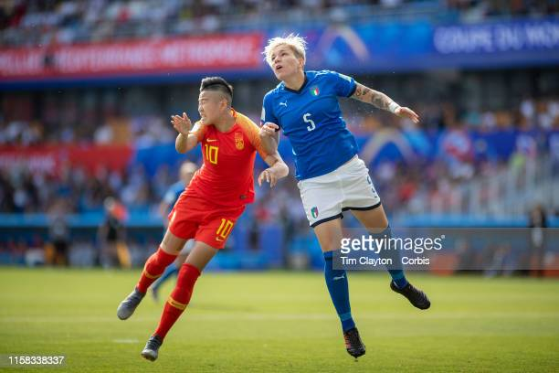 June 25 Elena Linari of Italy heads clear from Li Ying of China during the Italy V China round of sixteen match at the FIFA Women's World Cup at...
