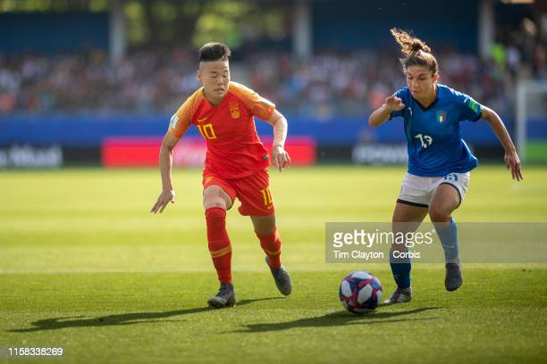 June 25 Li Ying of China defended by Elisa Bartoli of Italy during the Italy V China round of sixteen match at the FIFA Women's World Cup at Stade De...