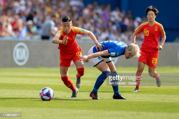 June 25 Li Ying of China dribbles past Elena Linari of Italy during the Italy V China round of sixteen match at the FIFA Women's World Cup at Stade...