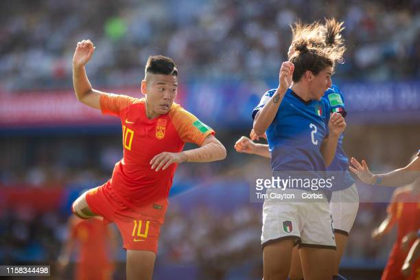 June 25 Li Ying of China heads goal wards past Valentina Bergamaschi of Italy during the Italy V China round of sixteen match at the FIFA Women's...