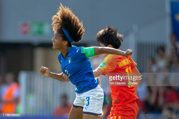 June 25 Sara Gama of Italy heads clear from Wang Shanshan of China during the Italy V China round of sixteen match at the FIFA Women's World Cup at...