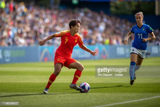 June 25 Wang Shuang of China defended by Barbara Bonansea of Italy during the Italy V China round of sixteen match at the FIFA Women's World Cup at...
