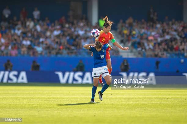 June 25 Wu Haiyan of China and Valentina Giacinti of Italy challenge for the ball during the Italy V China round of sixteen match at the FIFA Women's...