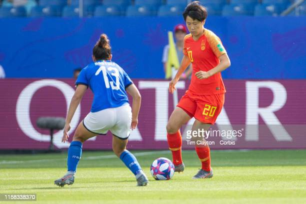 June 25 Zhang Rui of China defended by Elisa Bartoli of Italy during the Italy V China round of sixteen match at the FIFA Women's World Cup at Stade...