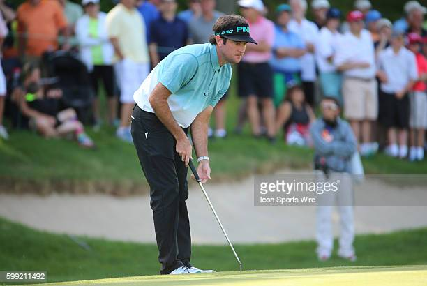 Bubba Watson studies his putt on 15 during the second round of the Traveler's Championship at TPC River Highlands in Cromwell Connecticut