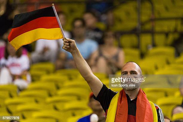 Germany fan waves a flag prior to the 2015 FIFA Women's World Cup Quarter final match between Germany and France at the Olympic Stadium in Montreal...
