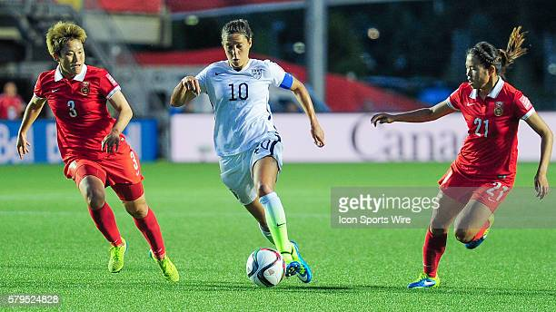 Goalscorer Carli Lloyd of USA runs between Pang Fengyue and Wang Lisi of China during the FIFA 2015 Women's World Cup QuarterFinal match between...