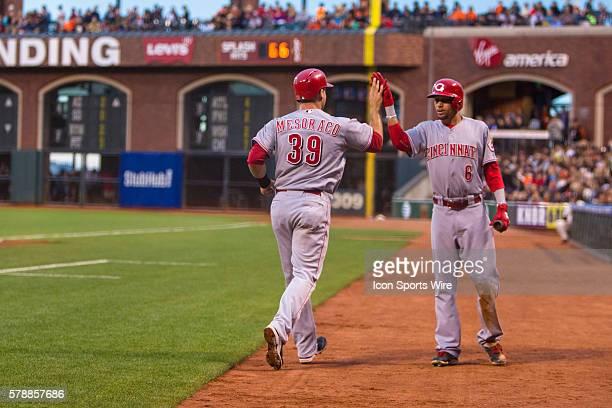 Cincinnati Reds catcher Devin Mesoraco celebrates scoring in the 5th inning with Cincinnati Reds center fielder Billy Hamilton during the game...