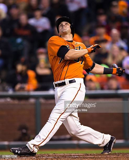 San Francisco Giants third baseman Adam Duvall at bat and following the trajectory of the ball afar connecting during the game between the San...