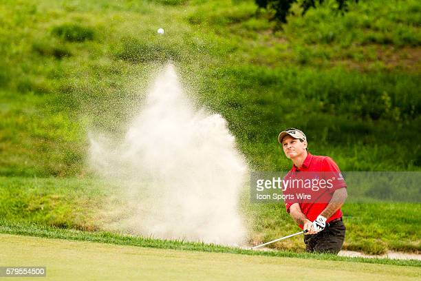 Mark Wilson hits from a green side bunker on 16 during the third round of the Travelers Championship at TPC River Highlands in Cromwell CT
