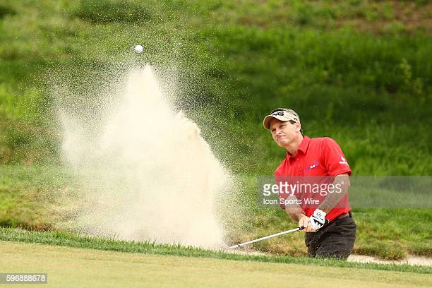 Mark Wilson hits out of the bunker on 16 during the third round of the Travelers Championship at TPC River Highlands in Cromwell CT