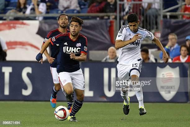 New England Revolution midfielder Lee Nguyen chased by Vancouver Whitecaps midfielder Matias Laba The Vancouver Whitecaps defeated the New England...