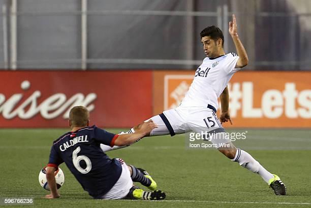 Vancouver Whitecaps midfielder Matias Laba nudges the ball past New England Revolution midfielder Scott Caldwell The Vancouver Whitecaps defeated the...