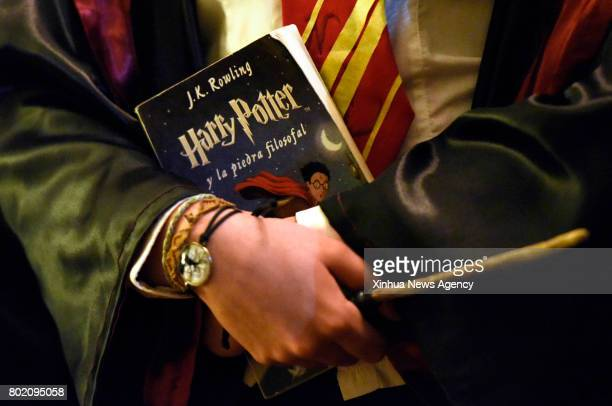 MONTEVIDEO June 27 2017 A Harry Potter fan holds a copy of Harry Potter and the Philosopher's Stone during an event to mark the 20th anniversary of...