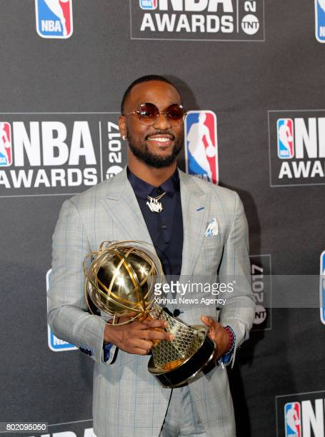 NEW YORK June 27 2017 Kemba Walker winner of NBA Sportsmanship Award poses for photo in the press room at the 2017 NBA Awards in New York the United...