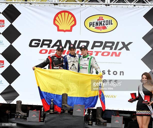Juan Pablo Montoya 2nd place Carlos Huertas 1st place Carlos Munoz 3rd place all from Columbia celebrate in winners circle for the IndyCar Series...