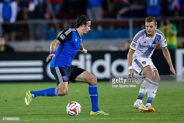 San Jose Earthquakes forward Alan Gordon passes the ball past Los Angeles Galaxy midfielder Robbie Rogers during the game between the San Jose...
