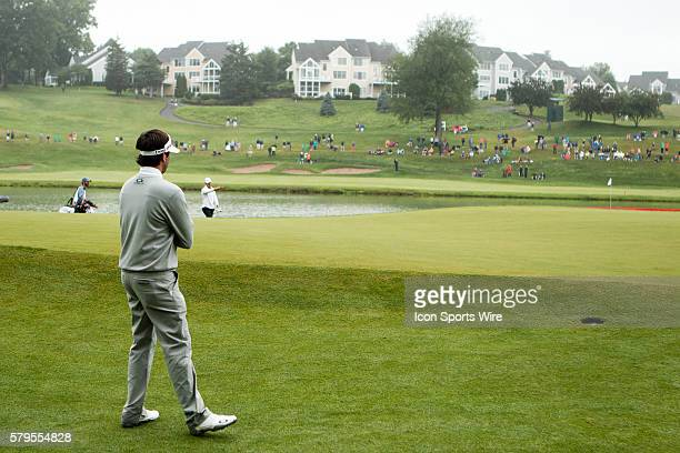 Bubba Watson studies the 15 on 15 during the final round of the Travelers Championship at TPC River Highlands in Cromwell CT