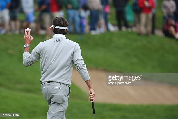Bubba Watson thanks the crowd leaving the 15th green during the final round of the Traveler's Championship at TPC River Highlands in Cromwell...
