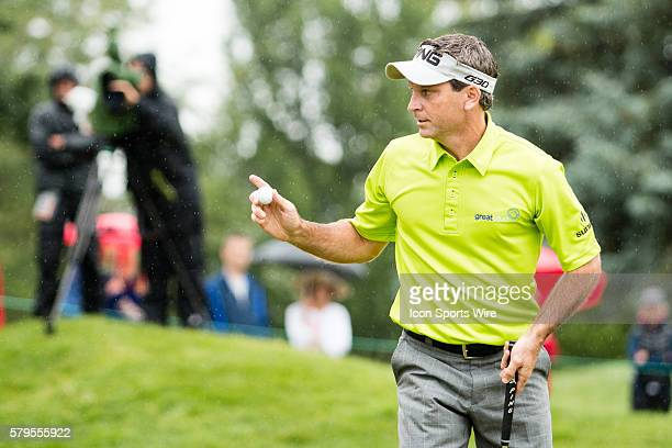 Mark Wilson acknowledges the gallery after making a birdie putt on 2 during the final round of the Travelers Championship at TPC River Highlands in...