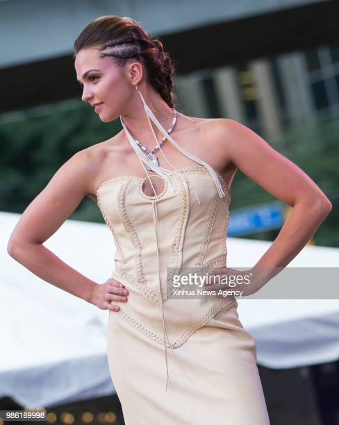 TORONTO June 28 2018 A model presents a creation by the local indigenous designer during the fashion show of the 2018 Aboriginal History Month...
