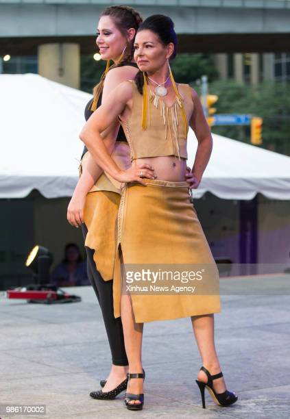 TORONTO June 28 2018 Models present creations by the local indigenous designer during the fashion show of the 2018 Aboriginal History Month...
