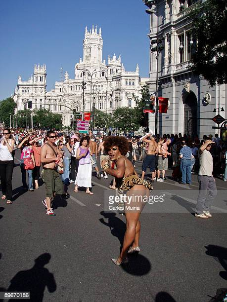 June 30 2007 Madrid Spain Pride Parade celebration In the photo a transexual showing the thighs At the back the Correos building