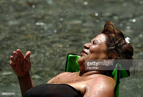 June 30, 2008. –––– Olivia Rickordis of Rialto, splashes water on her face while lounging in Lytle Creek stream in San Bernardino on June 30, 2008.