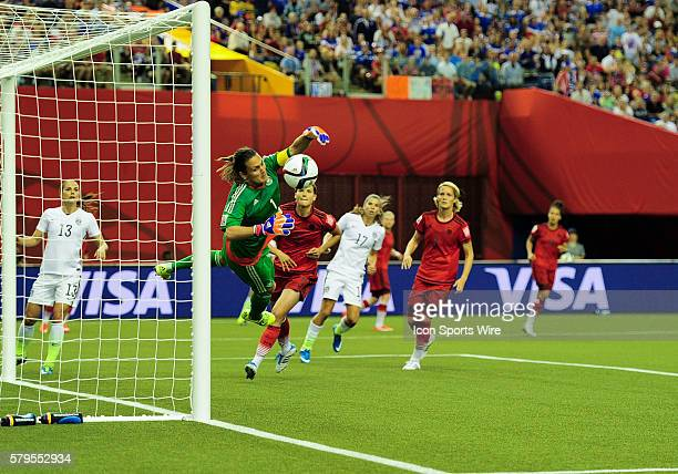 Goalkeeper Nadine Angerer of Germany at full stretch to palm away a shot at goal by Tobin Heath of USA during the FIFA Women's World Cup SemiFinal...