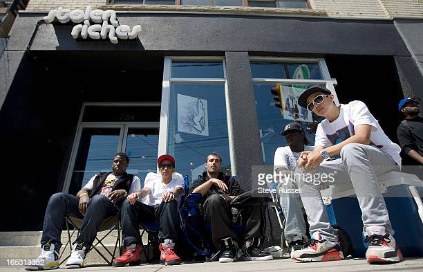 June 4 2009 Several youth from Buffalo line up outside a store on Queen West near Niagara St awaiting Kanye West sneakers that go on sale Saturday in...