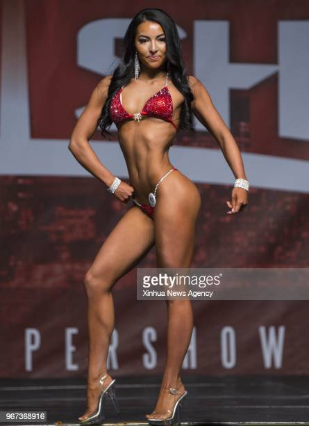A contestant competes during the women's bikini competition of IFBB Championships of 2018 Toronto Pro Supershow at Toronto Metro Convention Centre in...