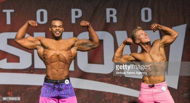 Contestants compete during the men's physique competition of IFBB Championships of 2018 Toronto Pro Supershow at Toronto Metro Convention Centre in...