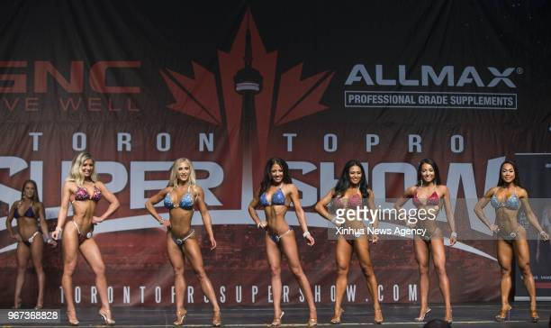Contestants compete during the women's bikini competition of IFBB Championships of 2018 Toronto Pro Supershow at Toronto Metro Convention Centre in...
