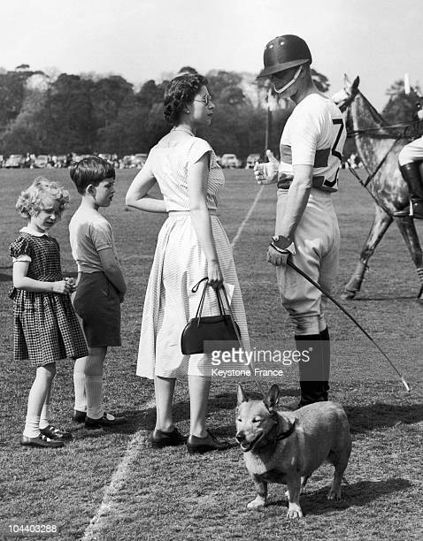 June 5, 1956: Accompanied by her two children, the Queen goes over to chat with the Duke of EDINBURGH during a pause in a polo game in Windsor Park.