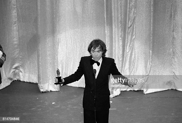 Andrew Lloyd Webber lifts his Tony award in appreciation 6/5 at the awards ceremony Webber won for best score of a musical for 'Cats' The musical won...