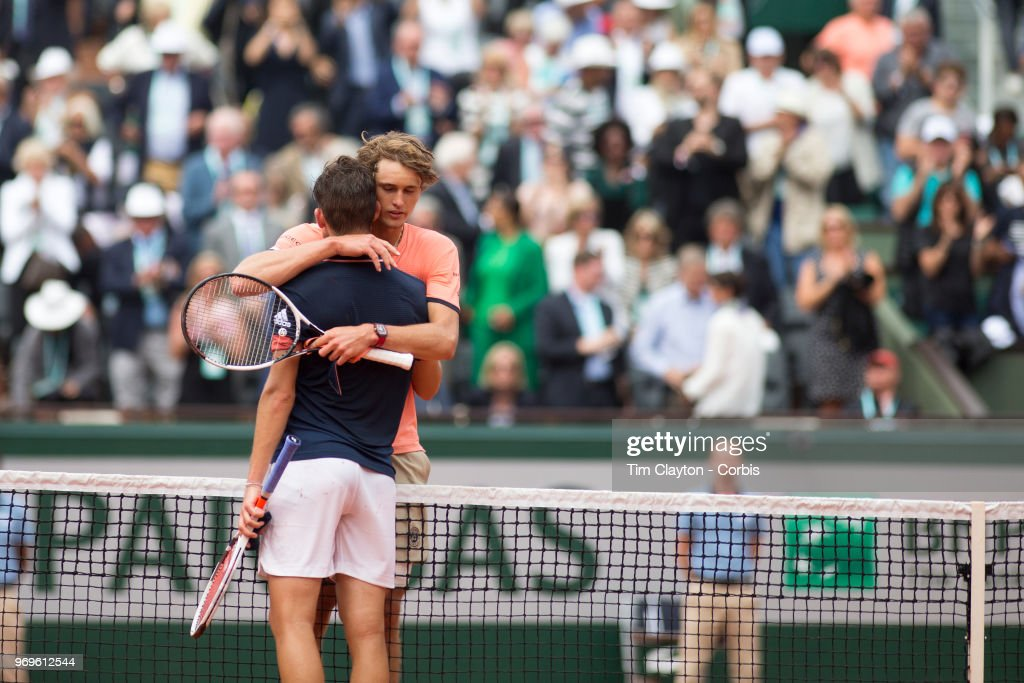 June 5. French Open Tennis Tournament - Day Ten.  Winner Dominic Thiem of Austria is embraced by Alexander Zverev of Germany at the end of the game on Court Philippe-Chatrier in the Men's Singles Quarter Finals at the 2018 French Open Tennis Tournament at Roland Garros on June 5th 2018 in Paris, France.