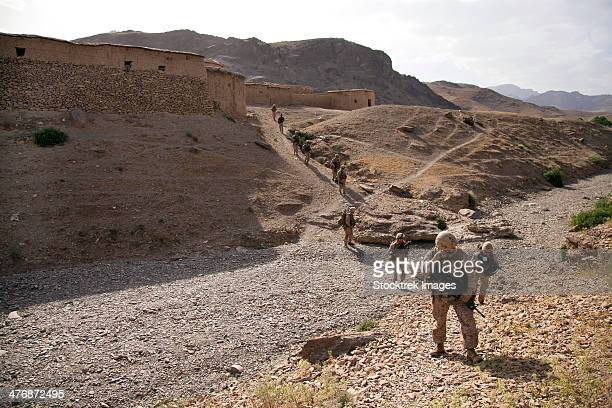 June 6, 2013 - U.S. Marines patrol through a village during Operation Nightmare in Now Zad, Helmand province, Afghanistan.