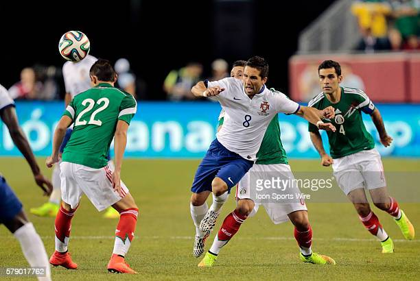 Mexico's Hector Herrera trips up Portugal's Joao Moutinho The men's national team of Portugal defeated the men's national team of Mexico 10 in a...