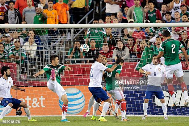 Mexico's Oribe Peralta tries to get the corner kick on frame The men's national team of Portugal defeated the men's national team of Mexico 10 in a...