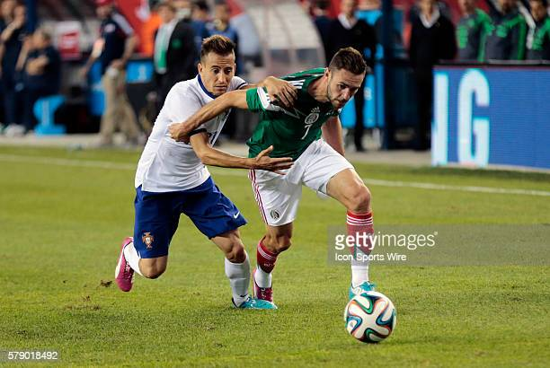 Portugal's Joao Pereira trying to hold back Mexico's Miguel Layun The men's national team of Portugal defeated the men's national team of Mexico 10...