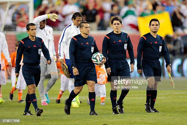 Referee Jeffrey Solis with ball leads the teams onto the pitch The men's national team of Portugal defeated the men's national team of Mexico 10 in a...