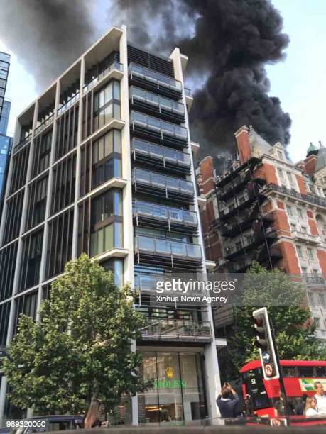 LONDON June 6 2018 Photo taken on June 6 2018 shows a massive blaze engulfs Mandarin Oriental Hotel in London's Knightsbridge Britain 15 fire engines...