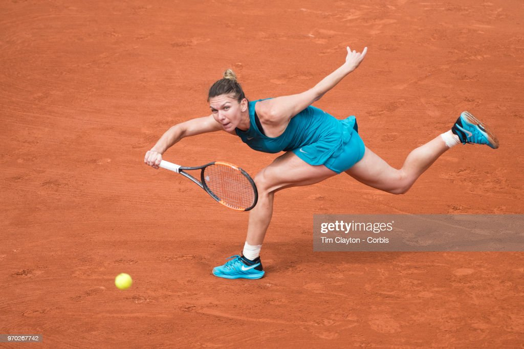 June 6. French Open Tennis Tournament - Day Eleven.  Simona Halep of Romania in action against Angelique Kerber of Germany on Court Suzanne Lenglen during the Women's Singles Quarter Finals at the 2018 French Open Tennis Tournament at Roland Garros on June 6th 2018 in Paris, France.