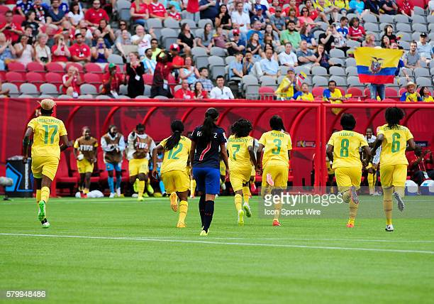 Cameroon players run to celebrate a goal with their bench during their win over Ecuador on Monday afternoon Pictured are Gaelle Enganamount Claudine...