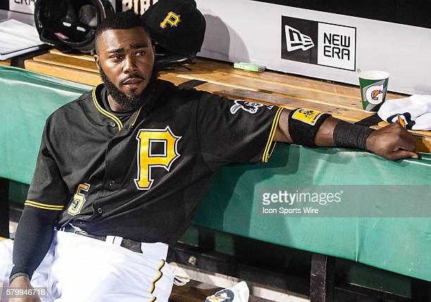 Pittsburgh Pirates third baseman Josh Harrison sits in the dugout during a rain delay in the seventh inning of game between the Milwaukee Brewers and...