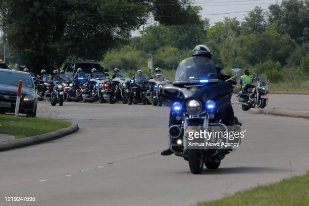 June 9, 2020 -- Police escort the hearse carrying George Floyd's casket from a funeral to a cemetery in Houston, Texas, the United States, on June 9,...