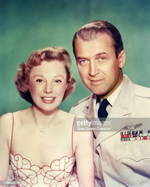 June Allyson US actress wearing a thin strap dress and James Stewart US actor in military uniform smiling in a publicity portrait issued for the film...