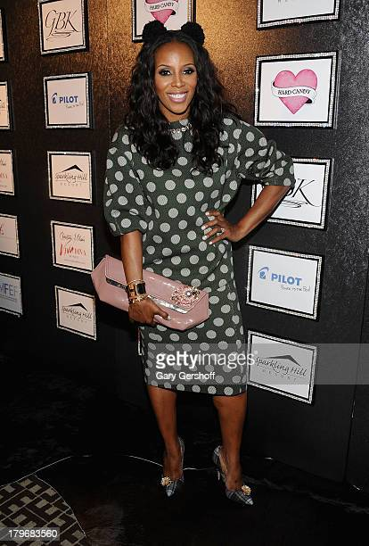 June Ambrose poses at the GBK Sparkling Resort Fashionable Lounge during MercedesBenz Fashion Week on September 6 2013 in New York City