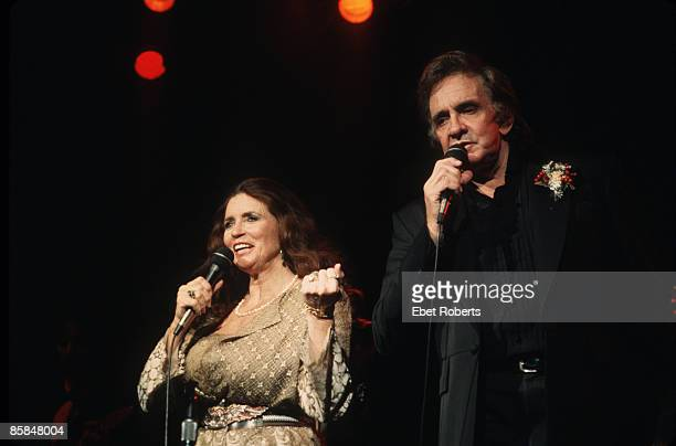 June Carter Cash and Johnny Cash perform on stage at The Ritz in New York City on December 16 1992