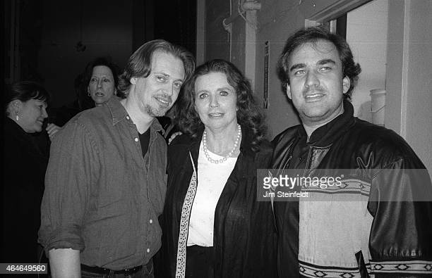 June Carter Cash Steve Buscemi and Michael Bodnarchek pose backstage at the Greek Theatre in Los Angeles California on June 14 1997